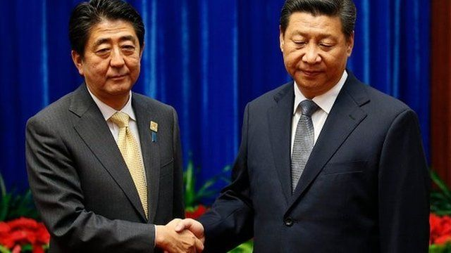 Chinese President Xi Jinping and Japanese PM Shinzo Abe