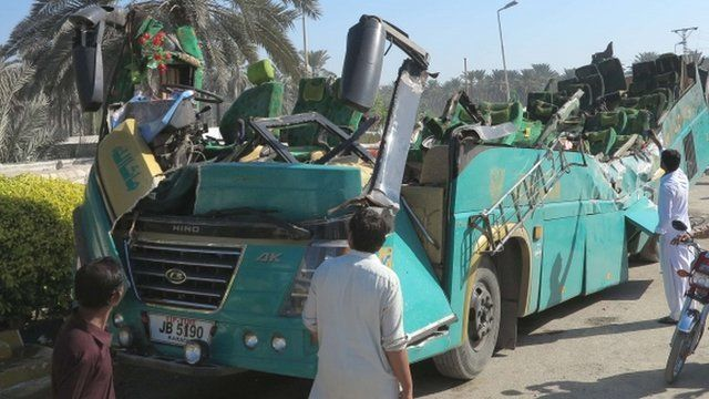 A Pakistani passenger bus with its roof ripped off the main body is pictured after the accident in Khairpur