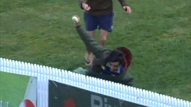 Andrew McCulloch takes an amazing catch in the crowd whilst watching cricket in New Zealand