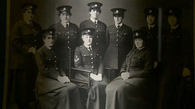 Women police officers sitting down wearing long skirts