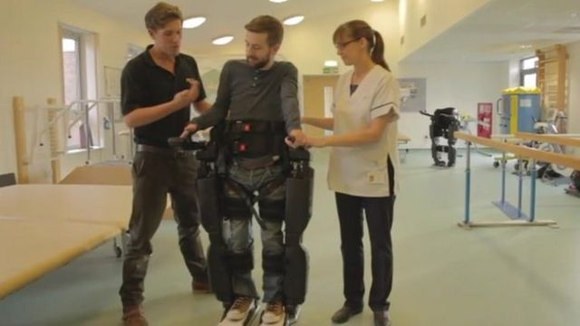 Gareth Herridge walks with help from the robotic skeleton