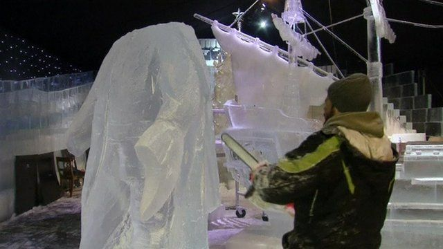 A man sculpts a statue out of ice