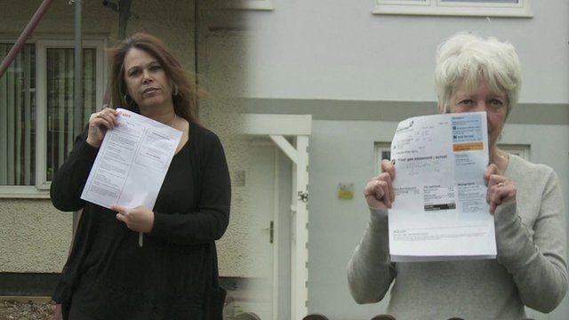 Women holding up energy bills