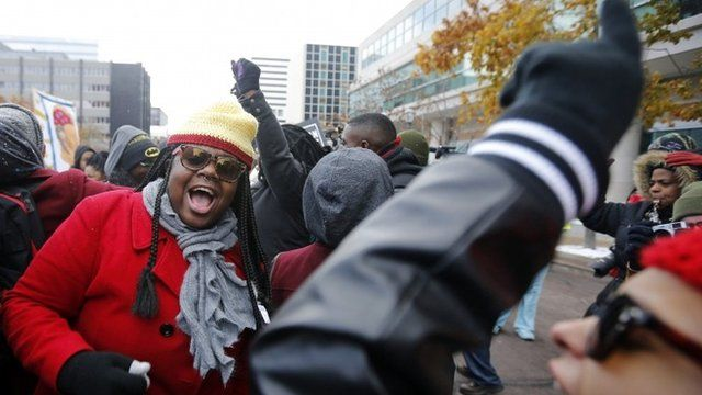 Demonstrators take part in a protest in front of the building where the grand jury is looking into the shooting death of Michael Brown in Clayton, Missouri, November 17, 2014