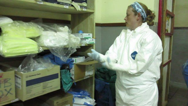 Dr Stacey Mearns puts on her protective clothing