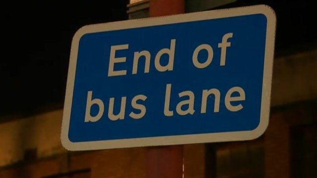 A sign on a bus lane