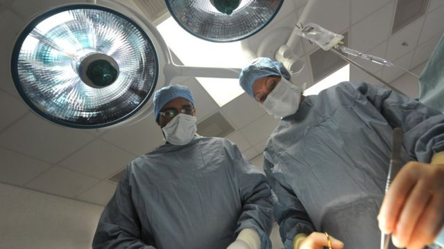 A surgeon performing an operation