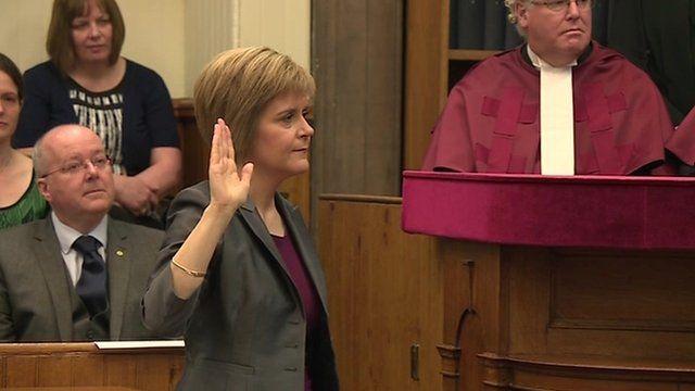 Nicola Sturgeon with hand raised to take oath