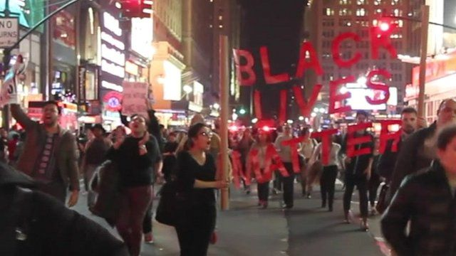 Protesters in New York carrying banner saying 'Black Lives Matter'