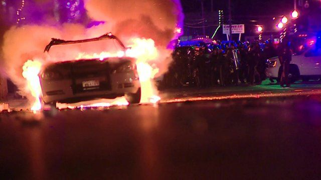 Rioters set fire to cars