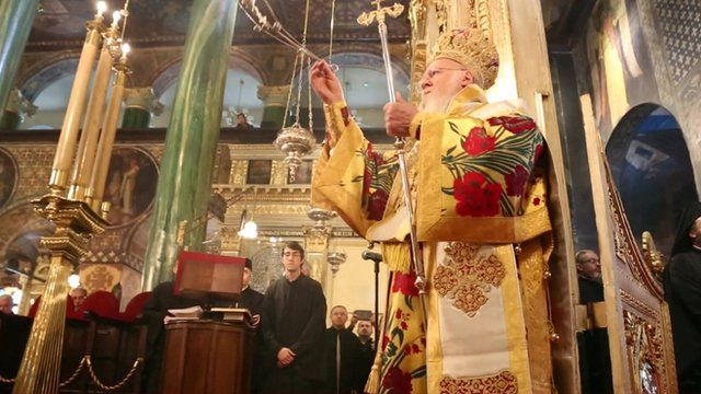 An orthodox priest carrying out a service