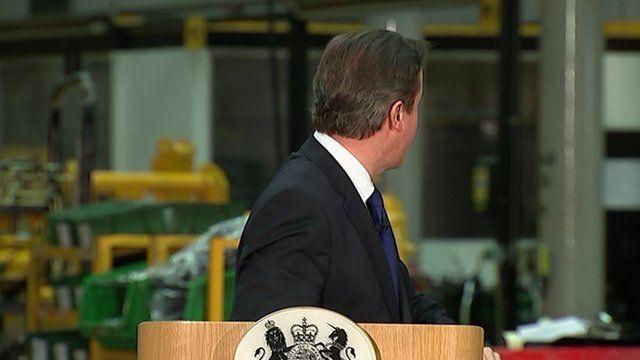 David Cameron glances over his shoulder