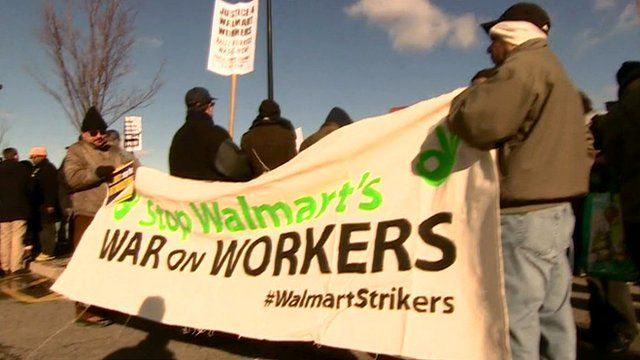 """Protesters hold a """"War on Workers"""" banner during the Black Friday strike"""