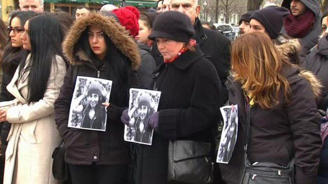 People holding pictures of Tugce Albayrak
