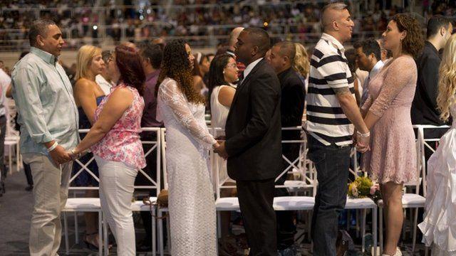 Couples marry during a massive wedding ceremony at the Maracanazinho gymnasium, in Rio de Janeiro, Brazil