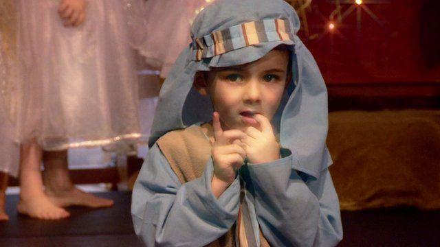 Small boy in shepherd costume