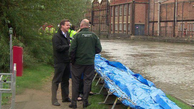 David Cameron examining flood defences