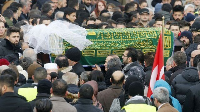 The coffin with Tugce Albayrak is carried away after a funeral ceremony outside a mosque in Waechtersbach, Germany
