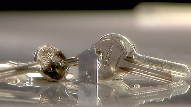 Close up of keys with key ring in shape of a house
