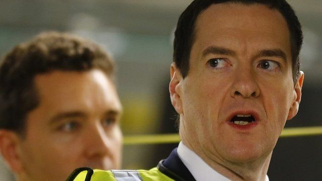George Osborne (right) looks at a car on the production line at Bentley Motors in Crewe