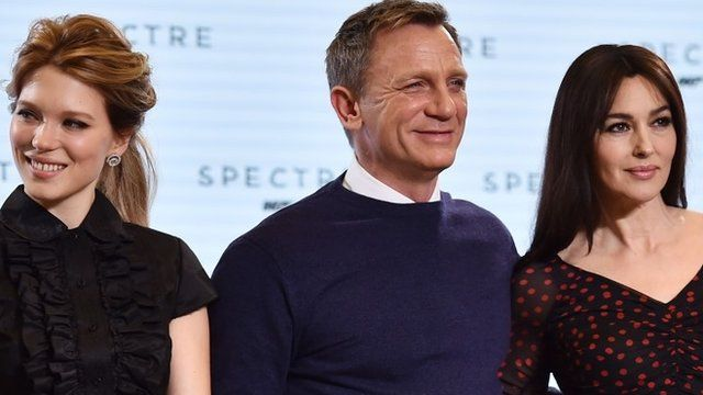 """British actor Daniel Craig (C), French actress Lea Seydoux (L) and Italian actress Monica Bellucci (R) pose during an event to launch the 24th James Bond film """"Spectre"""""""