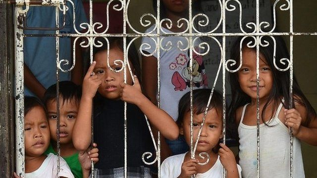 Children in school that has been turned into a shelter