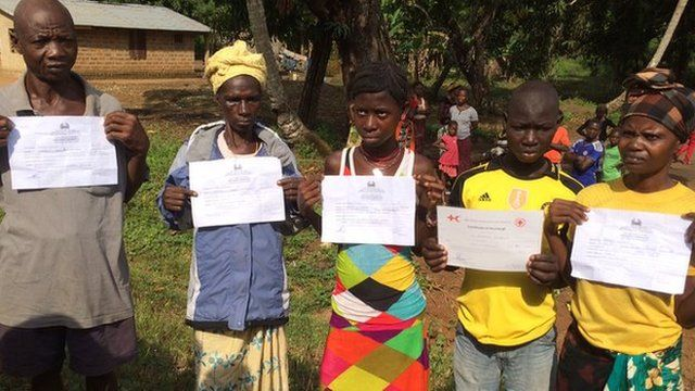 Ebola survivors with their certificates in Kigbal, Sierra Leone