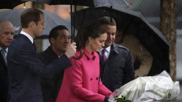 Duke and Duchess of Cambridge laying flowers