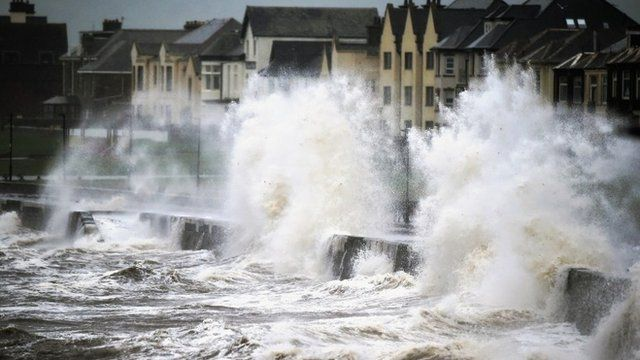 Waves crash over the promenade wall on December 9, 2014 in Prestwick, Scotland