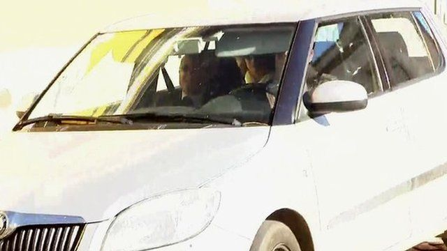 Robert Murat and his wife are driven to Faro Police Station for questioning
