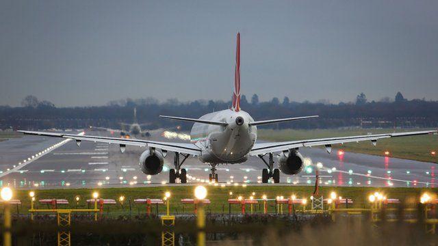 Passenger plane on Gatwick runway in 2013