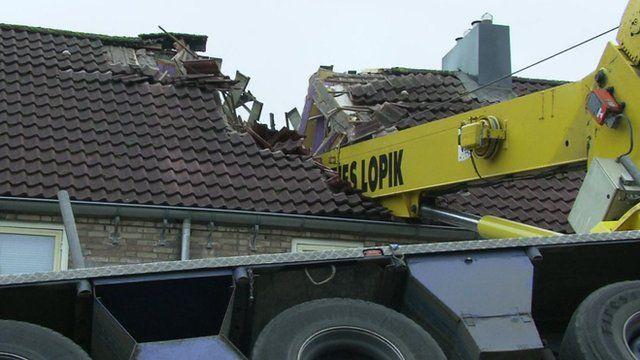 Crane stuck in roof