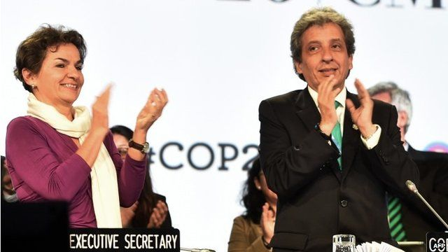 UNFCCC Executive Secretary Christiana Figueres and COP20 President and Peruvian Minister of Environment Manuel Pulgar clapping