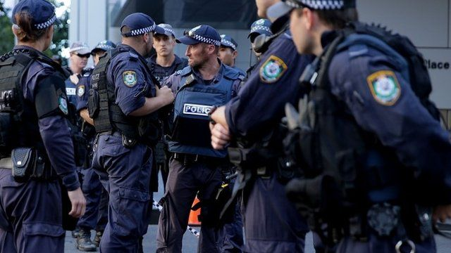 Police confer on Philip St near the Lindt Cafe, Martin Place on December 15, 2014 in Sydney, Australia