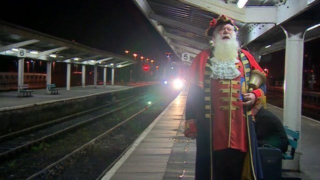 A town crier announced the train's departure
