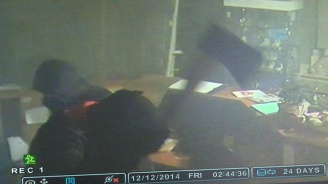 CCTV of burglars, including one wielding an axe