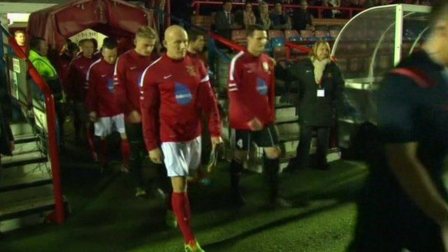 Football teams walking on to pitch