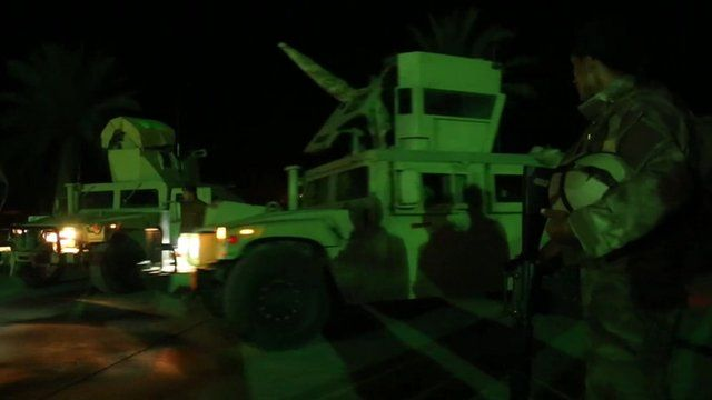 military vehicles at night