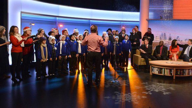 The BBC Singers, conductor David Hill and pupils from Glebe Primary & Canons High School