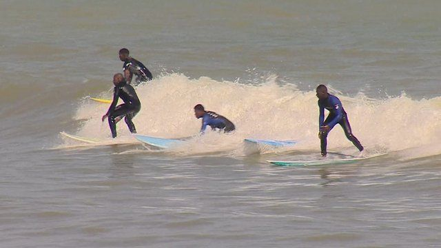 People surfing