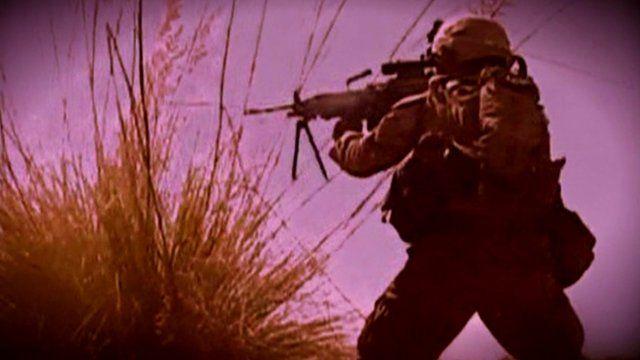 Man with machine gun