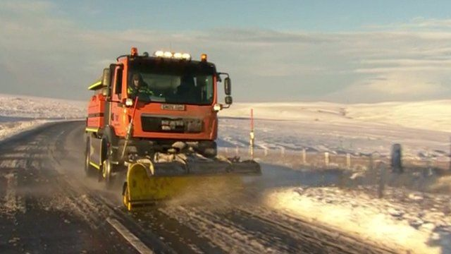 Snow plough clearing snow on road in Yorkshire Dales