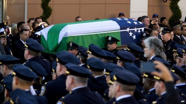 Police officers and coffin of Officer Ramos
