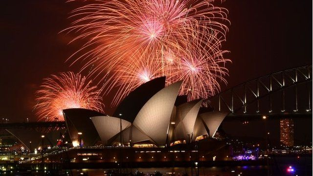 Early fireworks over Sydney Opera House and Harbour Bridge