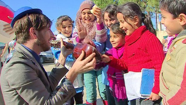 Clown interacting with Lebanese children