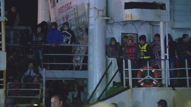 Migrants waiting to disembark