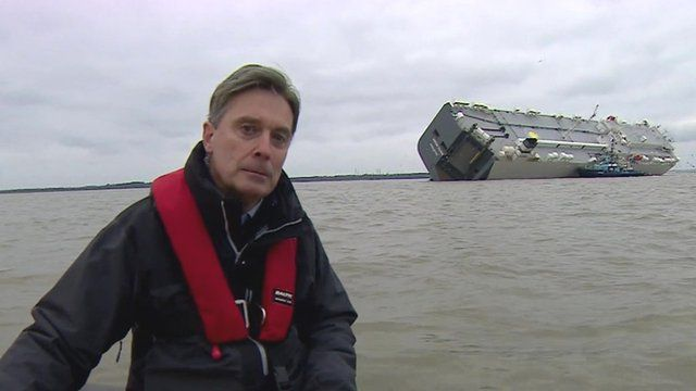 BBC reporter Duncan Kennedy reports from a dinghy near the stranded Hoegh Osaka car transporter