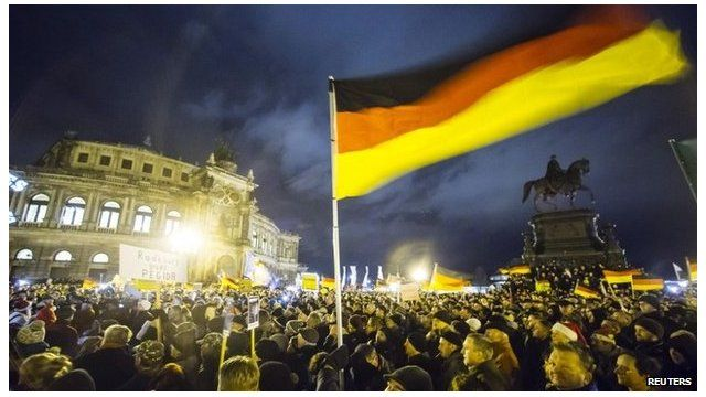 """A Pegida rally in Dresden, Germany, where support for the the group's stance against """"Islamisation"""" has grown"""
