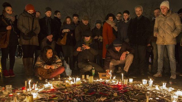Pens are thrown on the ground as people hold a vigil at the Place de la Republique (Republic Square) for victims of the terrorist attack, on January 7, 2015 in Paris
