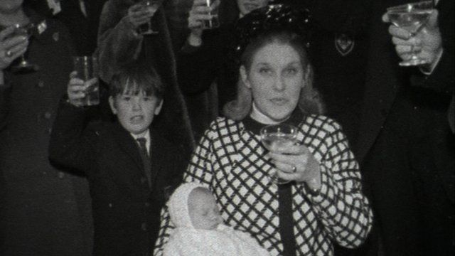 Glasses are raised at a christening in Northern Ireland in 1970
